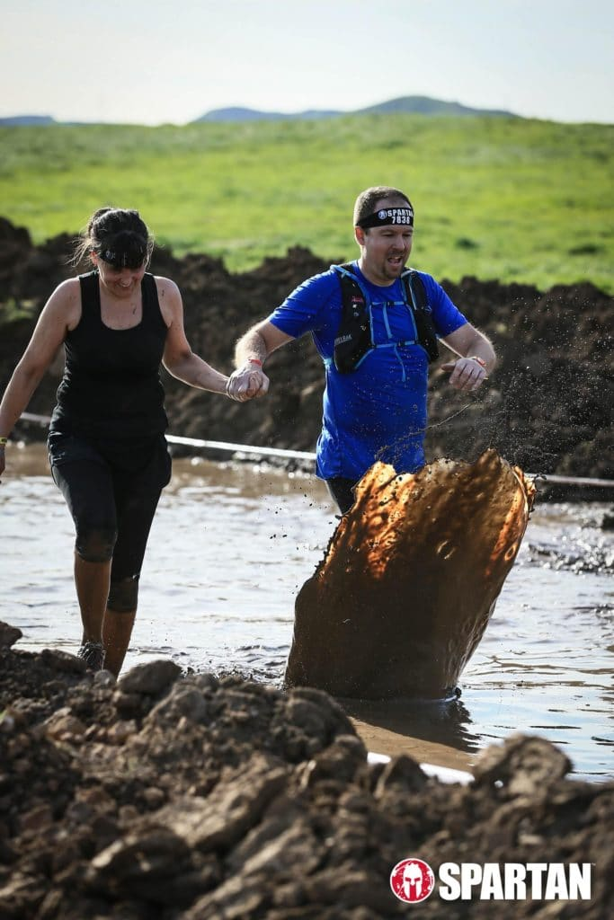 Couple running in the Spartan obstacle course race